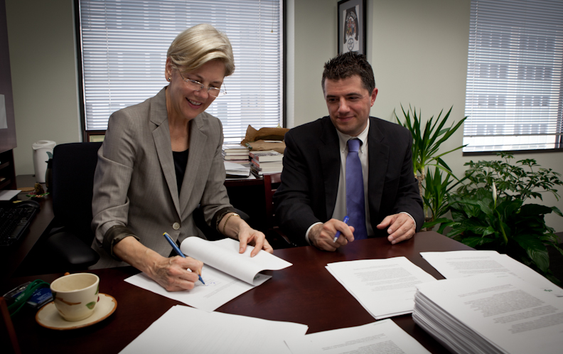 Professor Elizabeth Warren and Assistant Director for Large Bank Supervision Steve Antonakes sign introductory letters to the CEOs of over 170 financial institutions that are subject to CFPB Supervision.