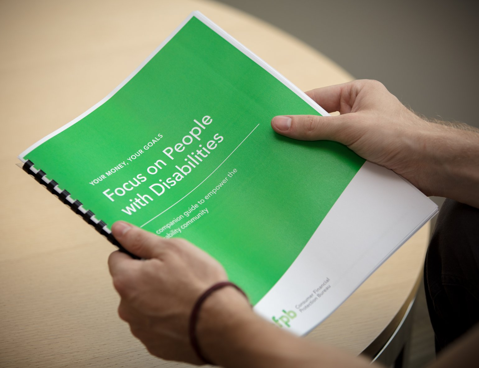 Photo of a person holding the Focus on People with Disabilities guide.