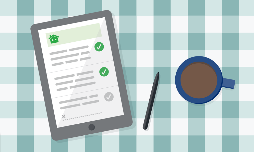 Checklist on an iPad next to a cup of coffee