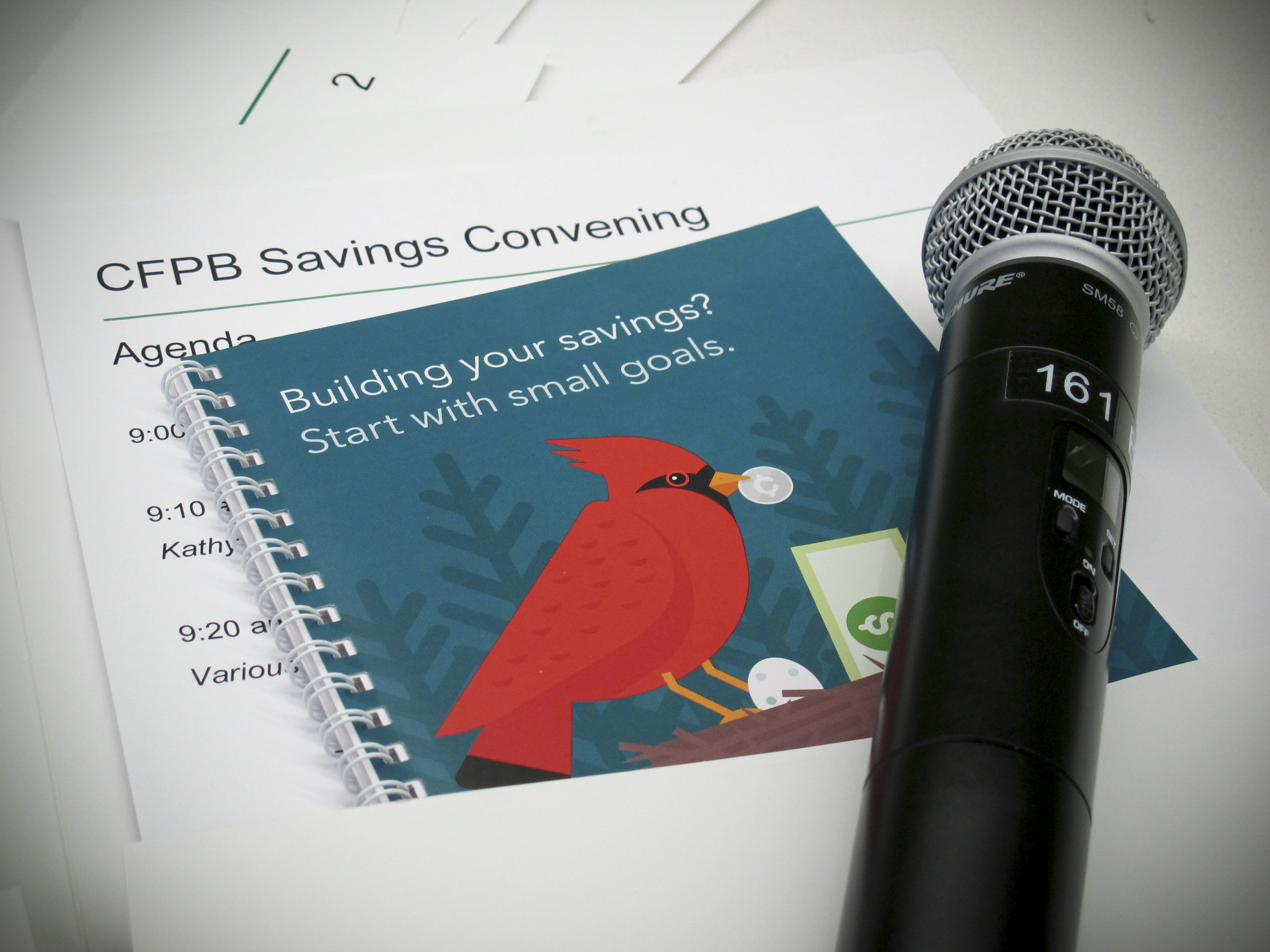 Microphone on top of conference handouts